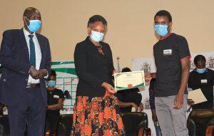KIPPRA_Board_Member_Dr_Fred_Simiyu_(left),KIPPRA_Executive_Director_Dr_Rose_Ngugi_(centre)_present_certificate_to_a_student