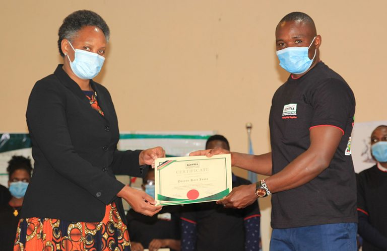 KIPPRA_Executive_Director_presents_certificate_to_a_student_at_the_KMPUs_event